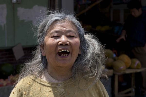 Elder chinese woman screaming