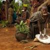 Suri women grinding, Omo Valley, Ethiopia