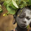 The Surma excel in face and body painting that is practiced daily in preparation of their dances and ceremonies. They pulverize locally found white chalk, yellow mineral rock, red iron ore and black charcoal to decorate their bodies often mimicking the spotted plumage of a guinea fowl.