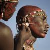 Samburu warriors painting for a ceremony, Northern Kenya