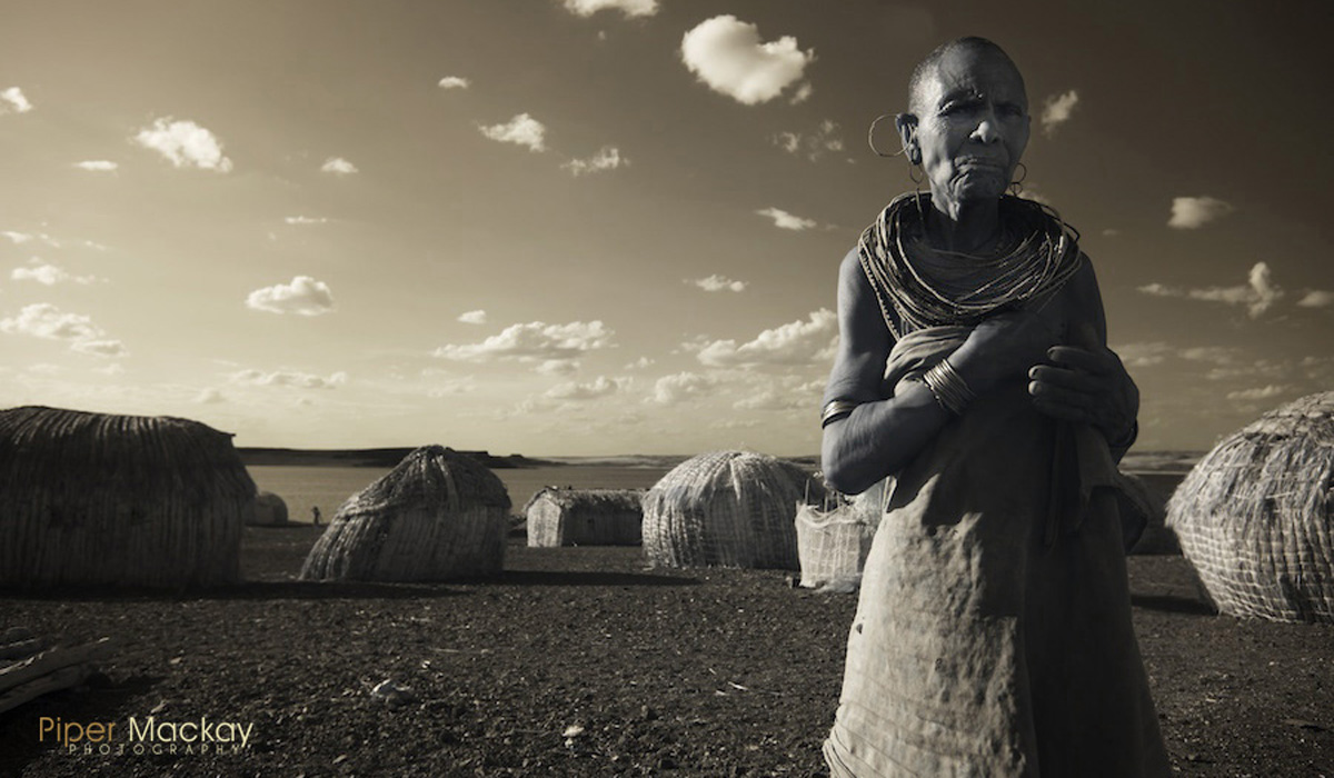 El Molo tribe women standing in the village along the shore of Lake Turkana