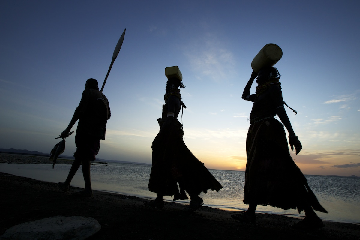 Turkana tribe walking along Lake Turkana