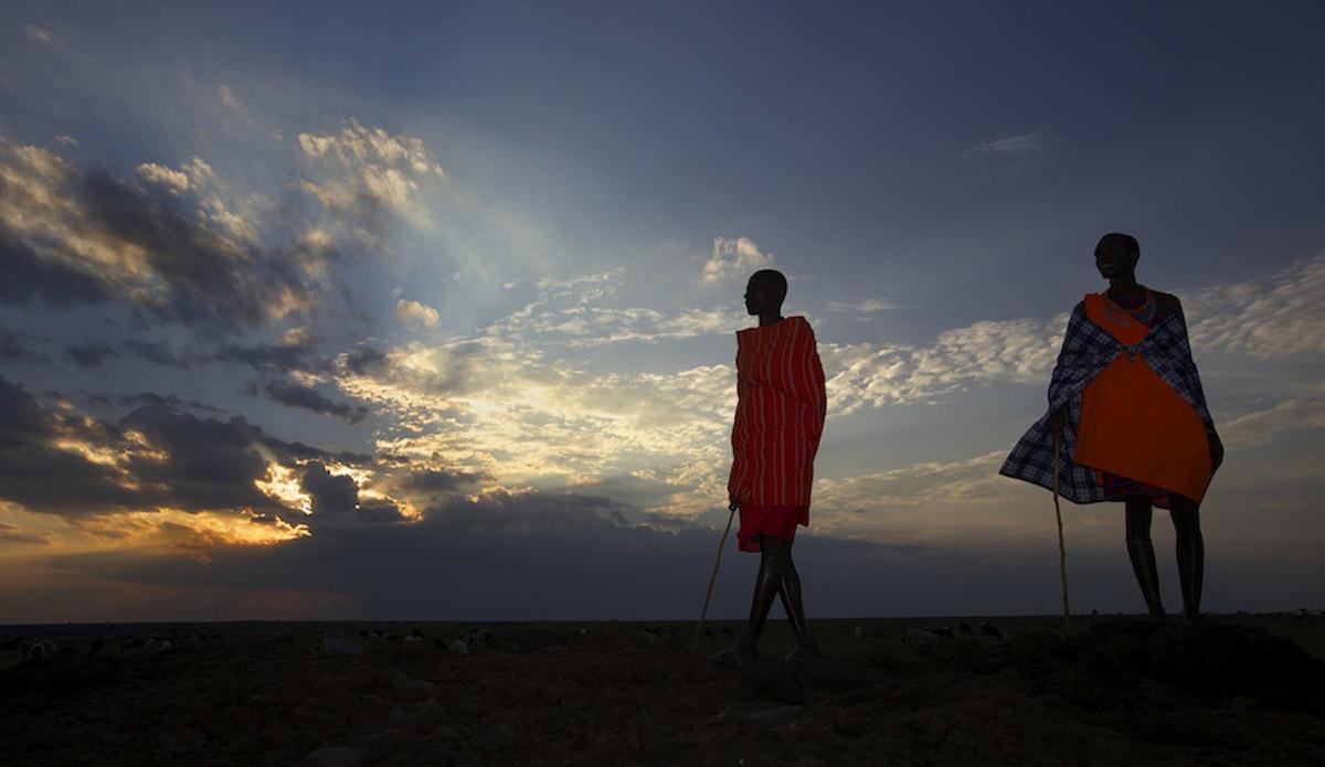 Maasai tribe out on the Maasai Mara at sunset