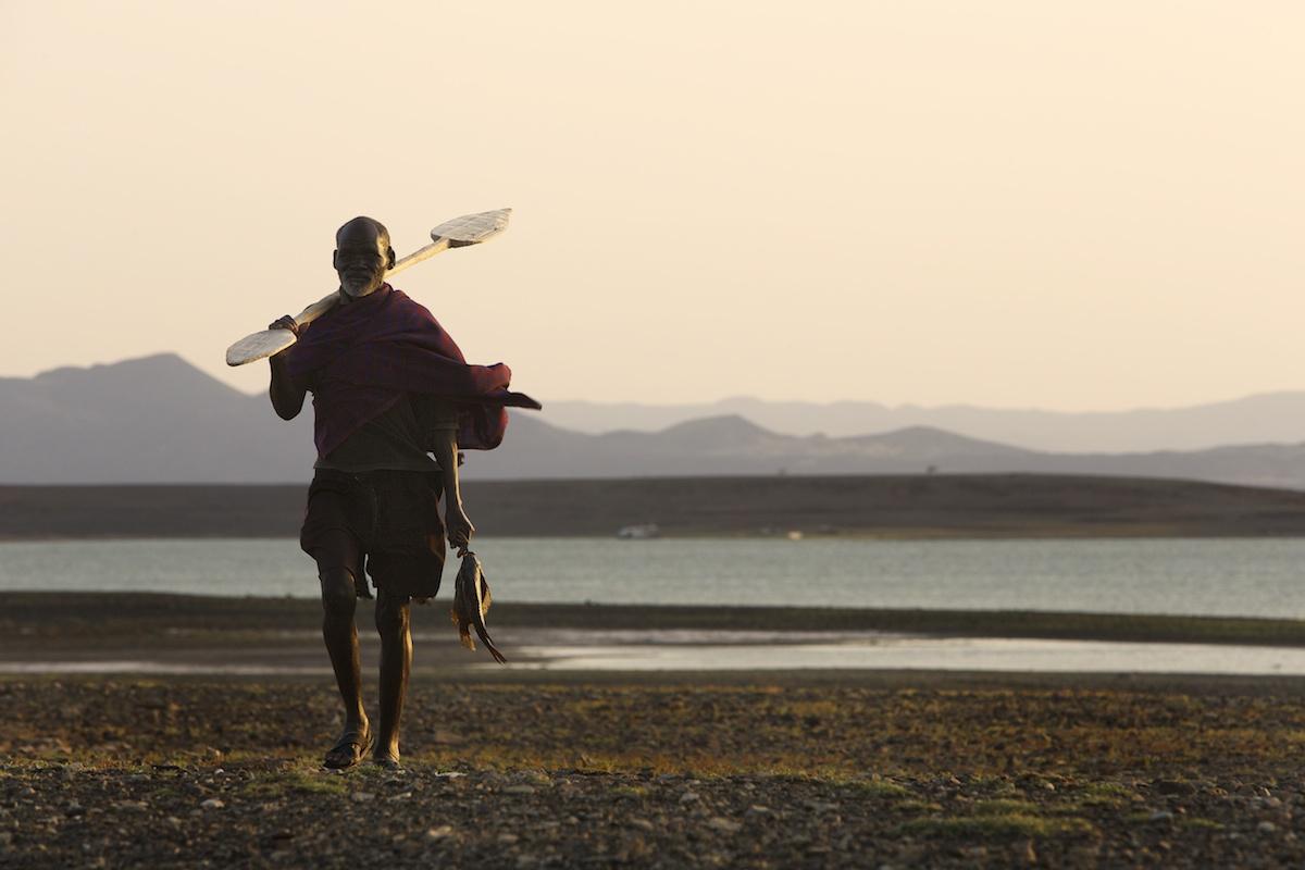 fisherman returning form a day of fishing on Lake Turkana, Northern Kenya
