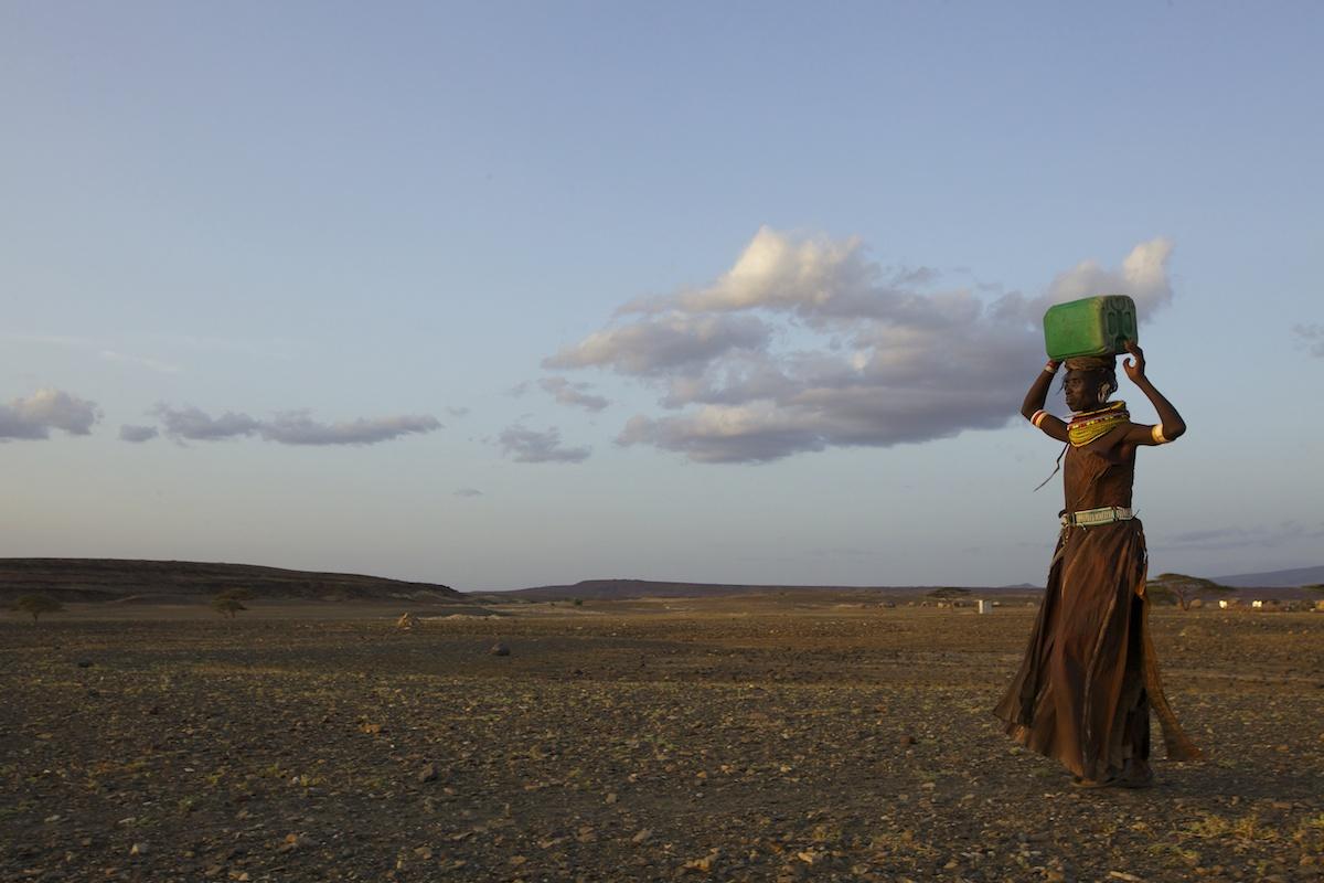 Turkana woman carrying water, Northern Kenya