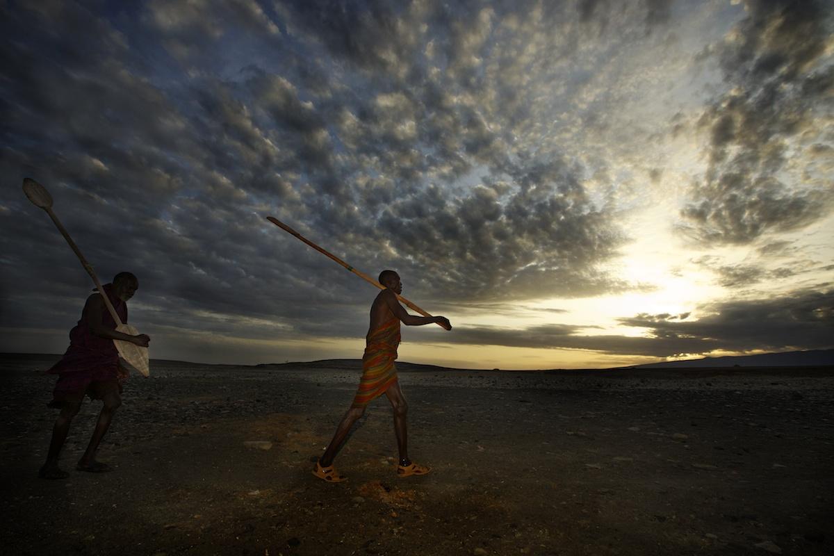 Fisherman walking down to Lake Turkana, Northern Kenya