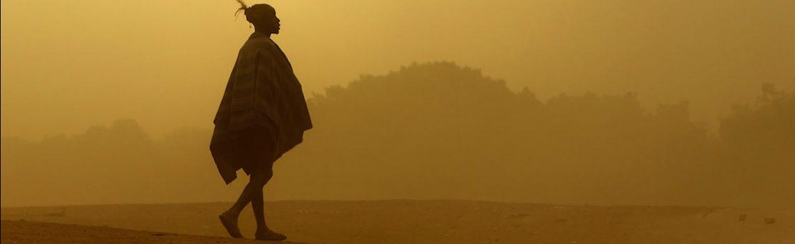 Hamar warrior walking through a dust storm in the Omo Valley